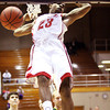 Jeffersonville senior Darryl Baker comes off a dunk against Floyd Central in 4A sectional play at Seymour. Staff photo by C.E. Branham