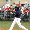 Providence batter Andrew Hunt rips a single against Jeffersonville Monday afternoon. Staff photo by C.E. Branham