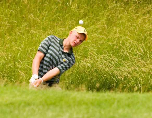 Floyd Central junior Jack Sparrow hits out of a grass bunker on the 16th hole during the final round of the state golf tournament at the Legends Golf Club in Franklin on Wednesday afternoon. Sparrow finished individually with a score of 151, and Floyd Central finished as a team in third place with an overall score of 580. Staff photo by Christopher Fryer