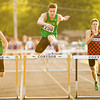Floyd Central senior Grant Foster clears the final hurdle before finishing first in the 300-meter hurdles during the Corydon Sectional on Thursday. Staff photo by Christopher Fryer