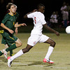 Jeffersonville junior Leonard Kwitonda drives past the Floyd Central defense during their game in the Indiana High School Athletic Association Boys Soccer Sectional tournament at Floyd Central on Wednesday. Jeffersonville won the game, 3-0. Staff photo by Christopher Fryer