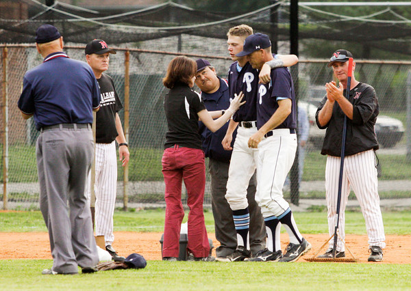 Providence third baseman Austin Dickey is helped off the field after being hit in the face with a ball between innings during their game against Corydon Central in the Sajko Invitational on Friday. Staff photo by Christopher Fryer