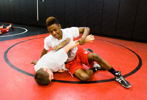 New Albany senior Lunden Bradford, right, and freshman Dakota Erickson work on wrestling positions during practice last week. Bradford was born clinically deaf, and this is his second year on the team. Staff photo by Christopher Fryer