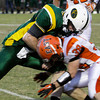 Floyd Central quarterback Bryce Smith is stopped by Columbus East's Christian Wichman during the second quarter of their game at Floyd Central on Friday. Staff photo by Christopher Fryer