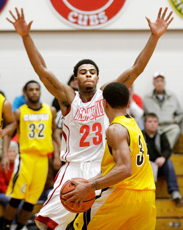 Jeffersonville forward Darryl Baker covers Clarksville guard Andrew Jones during their game at Jeffersonville on Friday. Jeffersonville won the game, 77-59. Staff photo by Christopher Fryer