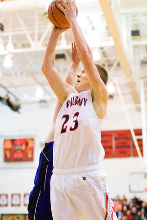 New Albany forward Isaiah Hickman goes up for a shot during the Bulldogs' home game against Seymour on Friday. Staff photo by Christopher Fryer