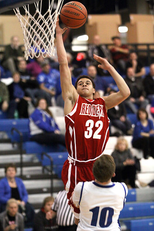 Jeffersonville junior Keenan Williams scores in transition at Charlestown Tuesday night. Staff photo by C.E. Branham
