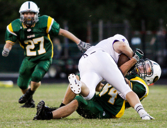 Floyd Central defensive back Nick Wagner tackles Seymour split end Adam Bowman during their game at Floyd Central on Friday. Staff photo by Christopher Fryer