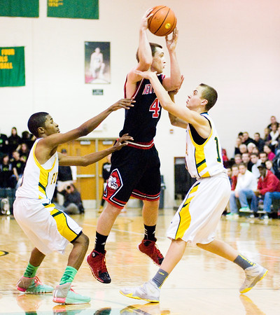 New Albany forward Jeff Byrne moves to pass during the Bulldogs' game at Floyd Central on Friday. New Albany won the game 49-45. Staff photo by Christopher Fryer