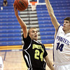 Henryville guard Landon Guthries drives against Charlestown Tuesday night. Staff photo by C.E. Branham