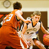 Henryville guard Elijan Weeks drives the ball down court during their game against Crawford County at the Crawford County Sectional on Tuesday. Crawford County won the game, 82-46. Staff photo by Christopher Fryer