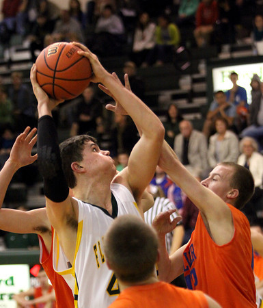 Floyd Central center Codie Hamsley scores in the post against Silver Creek Saturday night. Staff photo by C.E. Branham