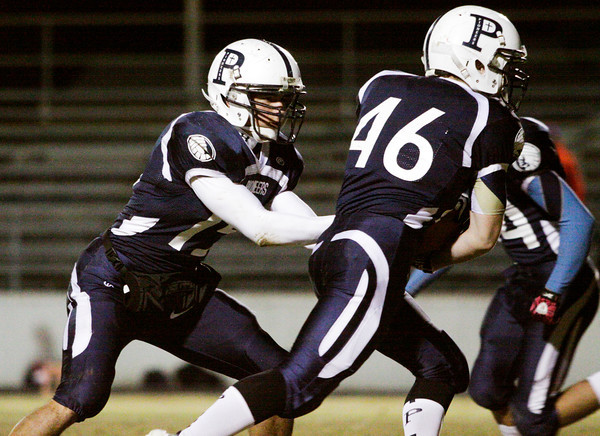 Providence quarterback Owen Mattingly hands off to Matthew Hayes during their Class 2A Sectional game at home against Emmerich Manual on Friday. Staff photo by Christopher Fryer
