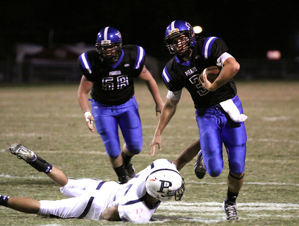 Charlestown quarterback Aaron Daniel avoids Providence defender Owen Mattingly on his way to a 41-yard touchdown Friday night. Staff photo by C.E. Branham