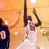 Rock Creek center Gedeon Nzombi goes up for a shot during their home game against Charlestown on Tuesday. Staff photo by Christopher Fryer