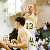 Floyd Central forward Colton Kimm goes up for a shot during their home game against Charlestown on Friday. Floyd Central won the game in double overtime, 81-79. Staff photo by Christopher Fryer
