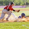 New Washington senior Corey Snider slides safely into third base past Borden junior Brian McGee during their game in the Lanesville sectional tournament on Friday. Staff photo by Christopher Fryer