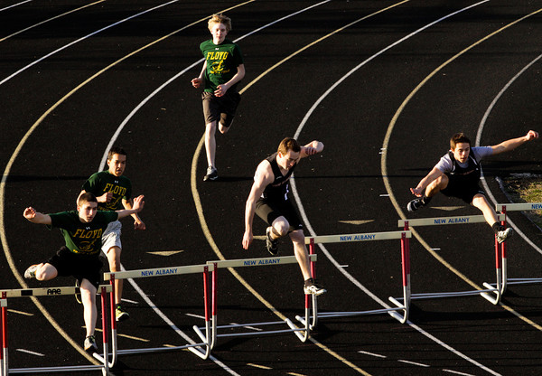 New Albany and Floyd Central runners compete in the 300-meter hurdles during their meet at New Albany on Tuesday. Staff photo by Christopher Fryer