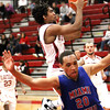 Indiana University Southeast junior, and Jeffersonville High School product, Kegan Clark drives to the hoop Wednesday night against Miami- Middletown. Staff photo by C.E. Branham