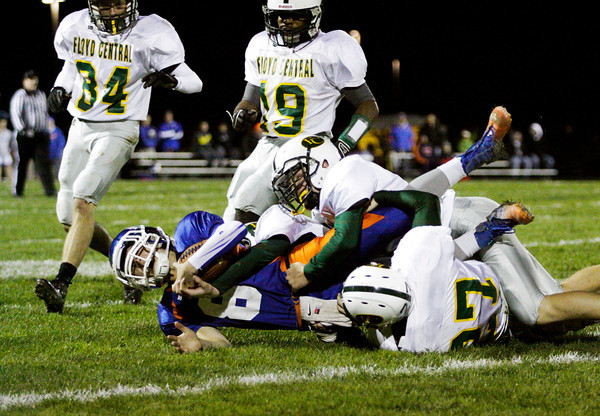 Whiteland quarterback Donnie Richard is brought down by the Floyd Central defense at the sectional championship game in Whiteland on Friday. The Highlanders lost the game, 41-20. Staff photo by Christopher Fryer