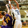 Clarksville forward Aidan McEwen is fouled while going up for a shot during their game against Eastern at the Crawford County Sectional on Friday. Staff photo by Christopher Fryer