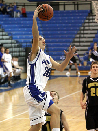 Charlestown guard Chris Braun lays in two as the Pirates hosted Henryville Tuesday night. Staff photo by C.E. Branham