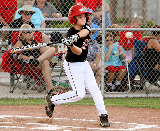 New Albany 9-10 All-Star Kevin Smith drives in a run against Silver creek Friday night in Charlestown. Staff photo by C.E. Branham