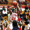 Jeffersonville senior Darryl Baker scores against Evansville Reitz Friday night. Staff photo by C.E. Branham