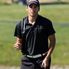 Henryville golfer Evan Embry clenches his fist after sinking a birdie putt on the tenth hole of the IHSAA Golf Regional on thursday at Champions Pointe Golf Club. Staff photo by C.E. Branham