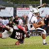 Providence quarterback Nathan Banet is tripped up in the back field by New Albany defensive tackle Damian McDuffy during their game in New Albany on Friday. Staff photo by Christopher Fryer