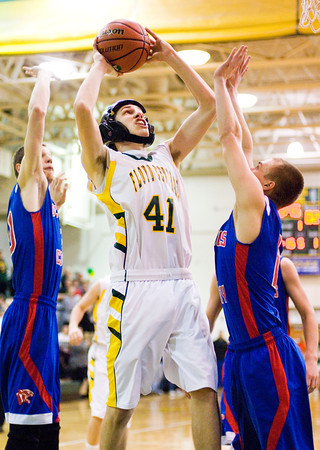 Floyd Central forward Connor Sturgeon goes up for a shot during the Highlanders' home game against Jennings County on Tuesday. Staff photo by Christopher Fryer