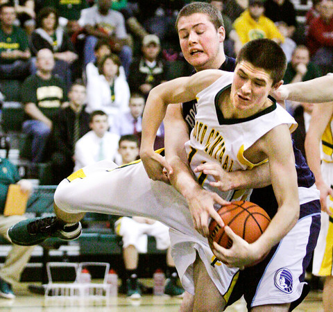 Providence forward Dalton Duley and Floyd Central guard Travis Foster struggle for possession of the ball during their game at Floyd Central on Saturday. Providence won the game, 43-31. Staff photo by Christopher Fryer