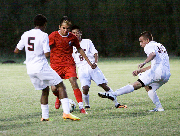 The New Albany defense attempts to stop Jeffersonville junior Jose Ojeda from taking a shot during their game at New Albany on Tuesday. Jeffersonville won the game, 2-1. Staff photo by Christopher Fryer