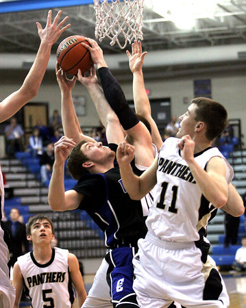 Charlestown guard Drew Reich, center, battles for a rebound with Corydon Central player in 3A sectional play Wednesday night. Staff photo by C.E. Branham