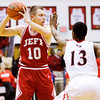 Jeffersonville senior Drew Ellis looks to pass during the Red Devils' game at New Albany on Friday. New Albany won the game, 67-56. Staff photo by Christopher Fryer