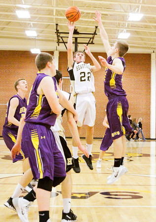 Henryville forward Bailey Reister goes up for a shot during the Hornets' home game against Eastern on Thursday. Staff photo by Christopher Fryer