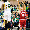 Jeffersonville senior Drew Ellis goes up for a shot during the Red Devils' game at Floyd Central on Friday. Floyd Central won the game, 71-70. Staff photo by Christopher Fryer