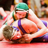 Floyd Central freshman Karl Hauser wrestles Eastern senior Nick Lanham during their 195-pound match at the Jeffersonville Sectional on Saturday. Hauser took the match in an 8-5 decision win over Lanham. Staff photo by Christopher Fryer