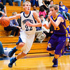 Providence guard Brock Hayden drives to the basket during the Pioneers' home game against Scottsburg on Saturday. Providence won the game, 51-43. Staff photo by Christopher Fryer