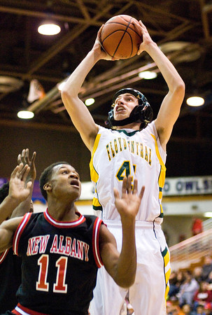 Floyd Central sophomore Connor Sturgeon goes up for a shot during the Highlanders' game against New Albany at the Seymour Sectional on Tuesday. New Albany won the game, 57-43. Staff photo by Christopher Fryer