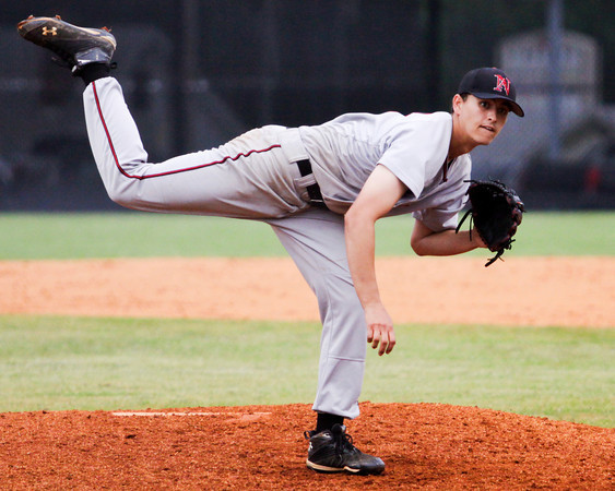New Albany senior Brandon Johnson pitches during the Bulldogs' 7-1 loss to Jeffersonville in the championship game of the New Albany Sectional on Monday. Staff photo by Christopher Fryer
