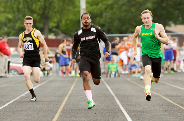 From left, Clarksville senior Zachary Sparks, New Albany senior Tuwan Payton and Floyd Central junior Gaige Klingsmith compete during the 100-meter dash at the Corydon Sectional on Thursday. Staff photo by Christopher Fryer