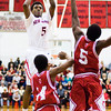New Albany junior Davon Winburn goes up for a shot during the Bulldogs' home game against Jeffersonville on Friday. New Albany won the game, 67-56. Staff photo by Christopher Fryer