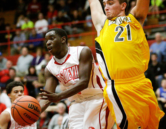 Jeffersonville's Jacquari Chandler decides to pass while going up for a shot during their home game against Clarksville on Friday. Jeffersonville won the game, 77-59. Staff photo by Christopher Fryer