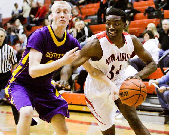New Albany forward DeAnthony Warren drives to the basket during the Bulldogs' home game against Scottsburg on Saturday. New Albany won the game, 77-59. Staff photo by Christopher Fryer