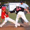 New Albany 11-12 All-Star Reece Davis tags Jeff/GRC runner Bailey Falkenstein for an out at second base Friday night. Staff photo by C.E. Branham