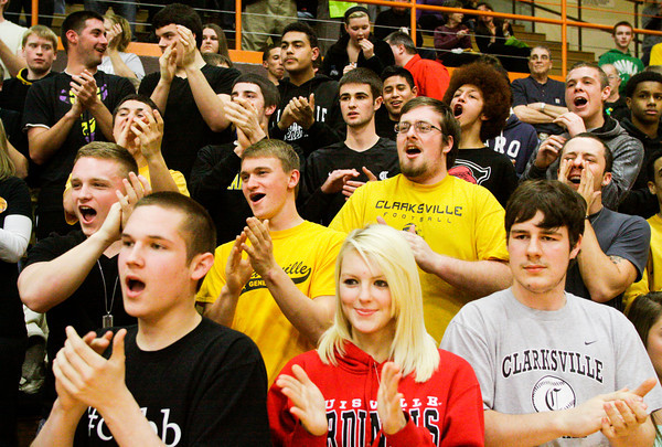 Clarksville fans cheer for their team as they are introduced at the beginning of their match up against Providence in the Crawford County Sectional on Tuesday. Clarksville won the game, 39-35. Staff photo by Christopher Fryer