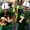 Floyd Central running back Gaige Klingsmith is congratulated by wide receiver Seth Jenkins after scoring a touchdown in the first half of their home game against Madison on Friday. Staff photo by Christopher Fryer
