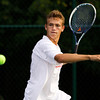 Jeffersonville sophomore Sam Coward moves to return the ball during his No. 1 doubles match with sophomore Jack Reilly against Floyd Central seniors Jack Stoner and Harrison Davis on Wednesday at Floyd Central. Staff photo by Christopher Fryer