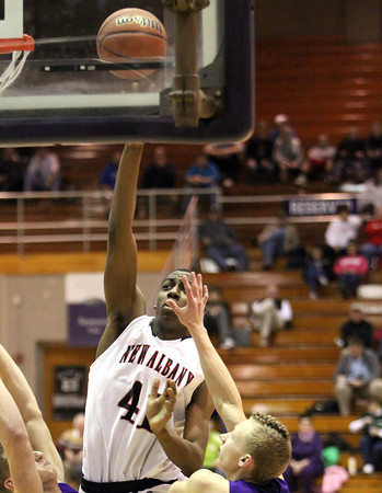 New Albany senior Anthony Edwards shoots in the lane aginst Seymour in 4A sectional play Tuesday night. Staff photo by C.E. Branham